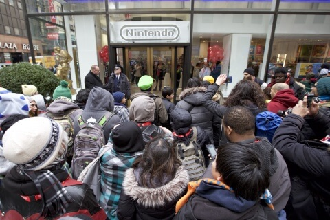 In this photo provided by Nintendo of America, Nintendo fans eagerly await to enter the grand reopening of the remodeled Nintendo NY store in Rockefeller Plaza on Feb. 19, 2016.