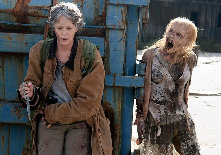 Carol about to be attacked by a walker