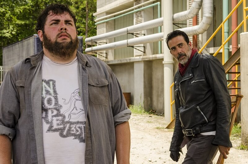 Negan and a Savior looking at an unseen Carl on The Walking Dead