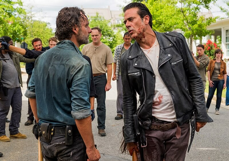 Rick facing off against a bloody Negan