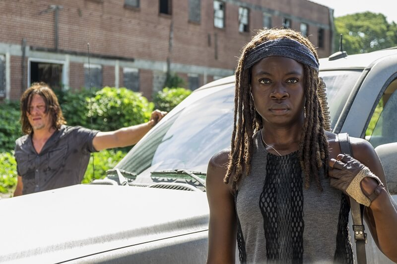 Michonne and Daryl standing outside their vehicle