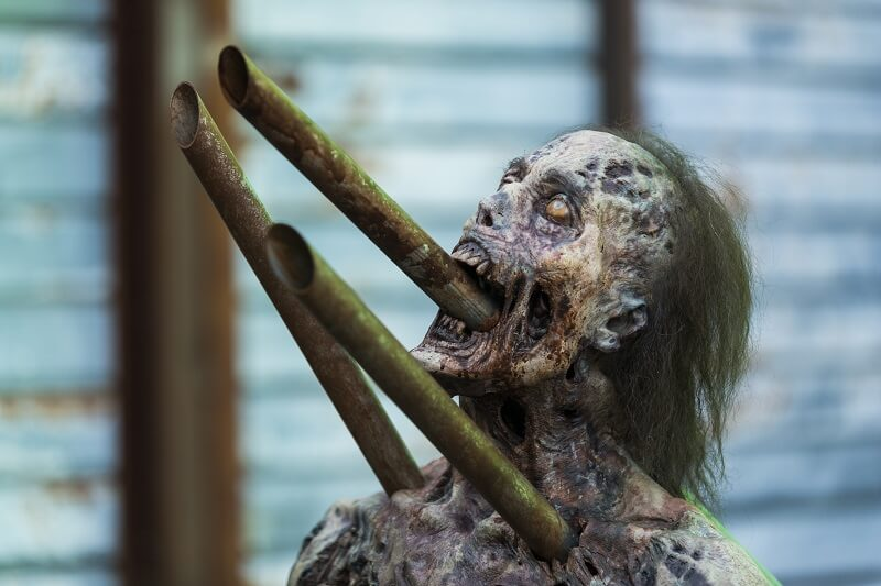 Walker stuck on posts on the walking dead