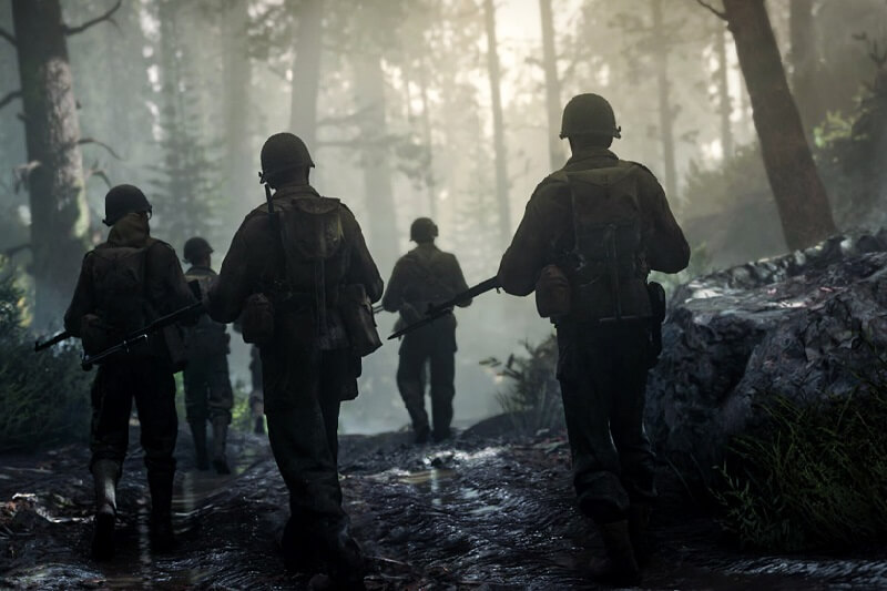 COD WWII screen shot of soldiers walking in woods