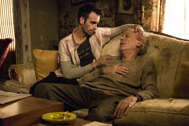 Joseph Gilgun as Cassidy, Ronald Guttman as Denis - Preacher _ Season 2, Episode 6 - Photo Credit: Michele K. Short/AMC/Sony Pictures Television