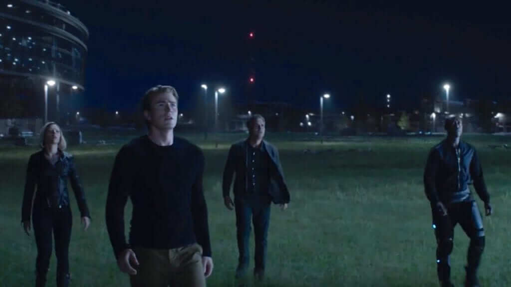 cap, black widow, bruce banner and war machine look at sky in avengers endgame