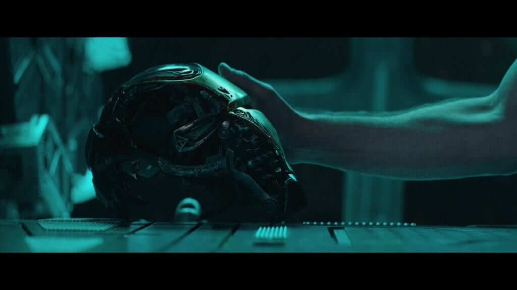Iron Man's battle damaged helmet being touched in Avengers Endgame