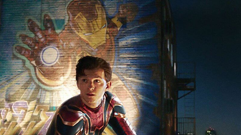Peter Parker with Iron Man mural in Spider-Man: Far From Home