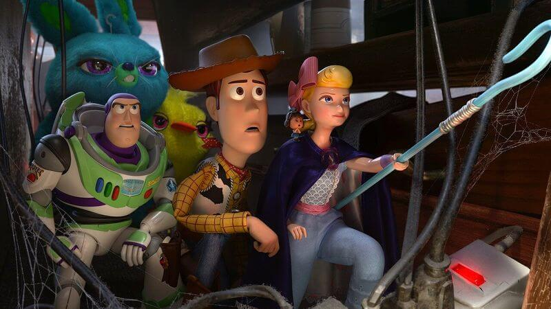 woody, buzz and company sneak around in Toy Story 4